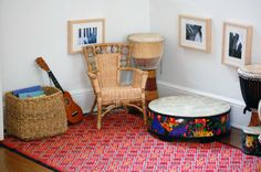 kid's play space corner, love the kid level pics and chair for playing the instruments