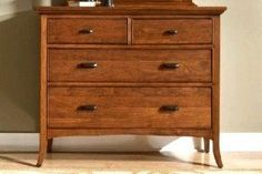 Dix Small Media Dresser Stylish dresser fitted with mirror and 4 drawers in various sizes. Suitable for storing clothes and other necessities. Functional piece of furniture for the bedroom, living room and more. It is highly rated by customers.