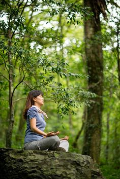 Young woman doing yoga meditation in deep forest     LEARN HOW TO STAY IN SHAPE THIS HOLIDAY SEASON    http://elitegreatness.com/blog/2012/11/26/learn-how-to-enjoy-this-holiday-season-while-still-losing-fat/