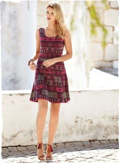 Traditional patterning from a West African textile looks contemporary in refreshing shades of raspberry, shale and charcoal. Jacquard knit of pima, the flirty sundress is engineered with strategically curved lines and side panels for a flattering, fit-and-flare shape.