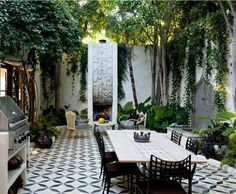In love courtyard with high walls, tiles floor and fountains greenery draping walls