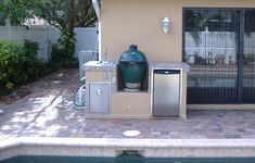 A grill and a smoker all in one. the Big Green Egg outdoor kitchen Big Green Egg Outdoor Kitchen, Green Eggs, Smokers, Grills, Backyards, Outdoor Ideas, Daddy, Deck, Gardens