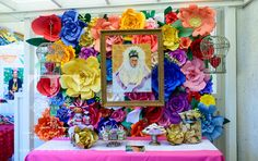What a beautiful paper flower backdrop for a Frida Kahlo birthday party! See more party ideas on CatchMyParty.com! #fridakahlo #paperflowers #papercrafts