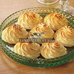 Duchess Potatoes Recipe _ A great choice for entertaining, Duchess Potatoes are cooked potatoes that are blended with egg yolks, butter and cream, piped into a decorative shape and baked. Serve with beef tenderloin or a pork roast for an impressive meal. Potato Dishes, Potato Recipes, Vegetable Recipes, Cheap Side Dishes, Saint Patrick, Potato Ricer, Creamed Potatoes, Mashed Potatoes, Tasty