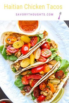 This Haitian Chicken Tacos is loaded with juicy, slightly spicy tender chicken thigh strips, and topped with vibrant, refreshing tomatoes. So easy to make and incredibly delicious. It's a Weekend miracle! #haitian #tacos #haitianfood #chickentacos #haitianstylerecipes #haitianrecipes #chickenstrips #tomatoes @msavorythoughts www.savorythoughts.com Best Chicken Taco Recipe, Chicken Tacos, Baked Chicken, Chicken Recipes, Haitian Food Recipes, Indian Food Recipes, Italian Recipes, Healthy Recipes, Spanish Recipes