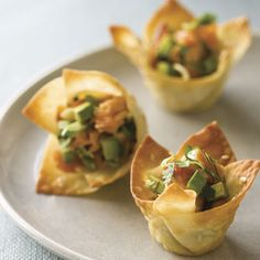 Possibly an alternative to Crab Rangoon? 24 square won ton or shumai wrappers; 2T unsalted butter, melted; 2t white sesame seeds; 4 ounces hot-smoked salmon flaked into small pieces; 1/2C finely sliced green onions; 1/4C finely chopped fresh cilantro; 1T lime juice; 2t grated fresh ginger; 1/2t kosher salt; 1 small avocado, finely diced; low-fat cream cheese?