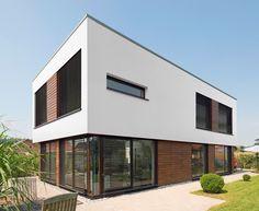 Das kern haus cube verk rpert kompromisslosigkeit in form for Moderner baustil einfamilienhaus