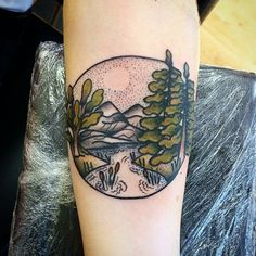 Superb arm tat with nice pastel-like coloring. Perfect expression of lake, mountains and woods.