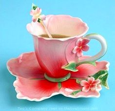What a beautiful pink tea cup and saucer crafted to resemble a hibiscus flower.  Stunning and elegant.