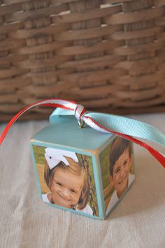 Make a Christmas ornament with a wooden block, an eye screw, and photos of your kids. *love*
