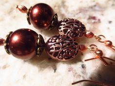 Brass and copper earrings by Somethingissparkling on Etsy, $20.00