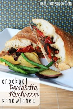 Crockpot Portabella Mushroom Sandwiches - Portabella mushroom caps slow cooked with roasted red peppers and zesty Italian dressing and then served on crusty rolls with pesto - these are SO good!