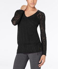 Take a look at this Lucy Black Blooming Lotus Burnout Top by lucy on #zulily today! $34.99  Cute, but kinda expensive for workout gear