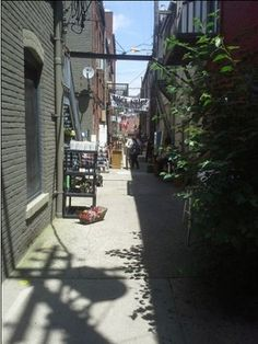 An argument for alleys. Is anyone designing alleys or laneways into new places?