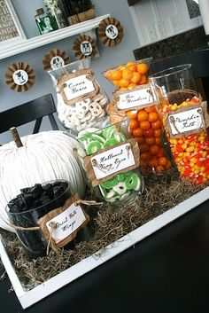 halloween candy bar! Love the tray and Spanish moss around the base of all the candy. And the white pumpkin And the labels! #halloween #party