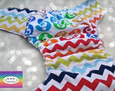 Rainbow Breastfeeding one size hybrid fitted by CandiePantsDiapers on Etsy.