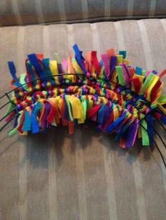 This wreath idea costs just 11 dollars to make, but it'll make your neighbors smile every time they knock on your door: Felt Wreath, Wreath Crafts, Diy Wreath, Mesh Wreaths, Wreath Making, Wreath Ideas, Cute Crafts, Diy Crafts, Birthday Decorations