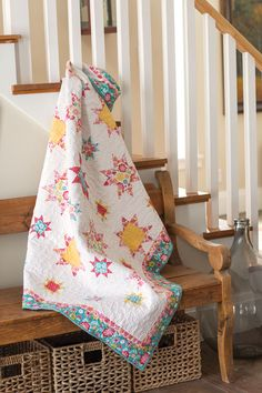 "This quilt features different sized sawtooth stars in modern vintage fabric prints. Designer Jennifer Schifano Thomas used ""modern"" vintage prints to make up these classic star blocks. Great quilt blocks and great prints – quilting doesn't get any more fun than this!"