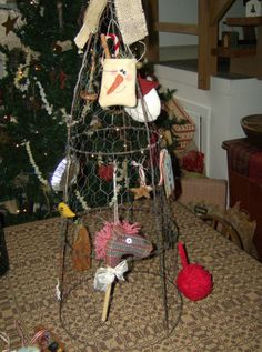 display for craft show at Christmas? Tomato cage covered in chicken wire.  Spray paint a bright color.