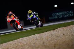 MotoGP 2014: Official DORNA SPORT SL Press Release. Marquez overcomes Rossi to take Qatar win. Marc Marquez and Valentino Rossi.
