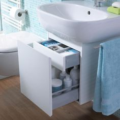 Neat! Bathroom sink with cupboard for small rooms.