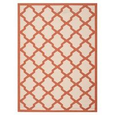 """Stylishly anchor your living room or patio ensemble with this artful indoor/outdoor rug, showcasing a quatrefoil trellis motif in terracotta and beige.  Product: RugConstruction Material: PolypropyleneColor: Beige and terracottaFeatures:  Quatrefoil trellis motifSuitable for indoor and outdoor useMade in Turkey Pile Height: 0.25"""" Note: Please be aware that actual colors may vary from those shown on your screen. Accent rugs may also not show the entire pattern that the corresponding area ..."""
