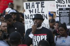People rally in Dallas on July 7, 2016, to protest the deaths of Alton Sterling and Philando Castile.