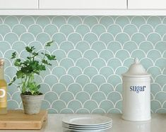 Perfect for creating a backsplash. Peel and stick tile panels with a high shine finish. Mint Shell Peel and Stick Tile. These peel and stick panels are perfect for a quick and easy makeover. The shell design has an inviting sea-foam green finish. Self Adhesive Backsplash Tiles, Peel Stick Backsplash, Backsplash Panels, Tile Panels, Peel And Stick Tile, Stick On Tiles, Peel And Stick Wallpaper, Wall Tiles, Wallpaper Backsplash Kitchen