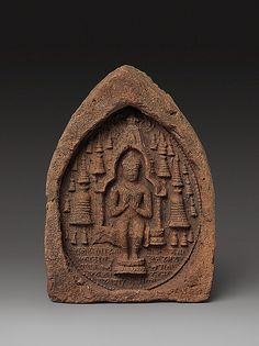 Votive Plaque: Seated Buddha in a Temple