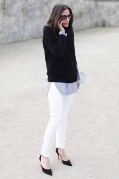 Capucine Safyurtlu in a layered button down, knit, white jeans & pumps...