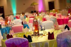 minimal sangeet decor on tables, nice colors bubs