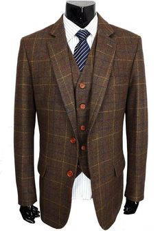 This smart, high-quality modern retro suit is for formal occasions. This top-end brown checked pattern suit made from the finest woolen tweed fabric, crafted with the highest level of detail adds a touch of individuality and interest, while still being suave and dapper. For weddings, christenings, cocktail parties or networking events. This three-piece woolen suit comes with a jacket, waistcoat, and trousers. The jacket and waistcoat are accessorized with bright brown buttons, while the…