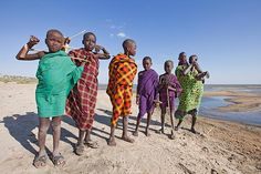 KENYA | NILOTIC young goat herders from the Turkana tribe, on the western shore of Lake Turkana, Kenya