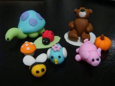 fondent icing animals including tortoise, bee, ladybird, teddy, pig and bird