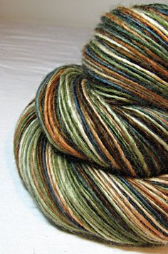 Luminous colour and spun single; you'd never know this didn't have silk in it. // Handspun Yarn Thick and Thin Single Blue Faced by SheepingBeauty, $34.00