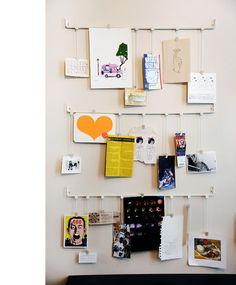 neat idea for hanging kids art, postcards, invites, etc.