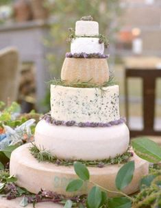 """a cheese wheel! Artisanal Cheese Wheel """"Cake"""" A great idea for cheese connoisseurs or perfect for a vineyard, garden, or farm wedding. Decorate the tiers with herbs, flowers, or various fruits. Wedding Cake Rustic, French Wedding, Farm Wedding, Wedding Cakes, Wedding Blog, Wedding Desserts, Buffet Wedding, Wedding Ideas, Herb Centerpieces"""