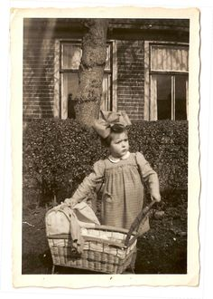 Little me with my vintage wicker doll's pram