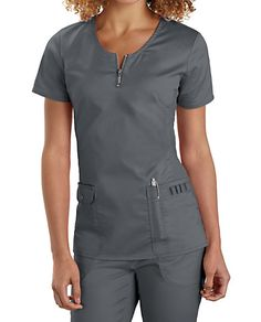 A PLACE FOR EVERYTHING Trendy knit side panels and a front neck zipper make this scrub top look like it was designed for fun, not work. Stay completely organized with four roomy pockets and lots of instrument loops. Beyond Scrubs Mia Zip Front Scrub Top Beyond Scrubs Mia Zip Front Scrub Tops Zip neck Stretch side panels with contrasting slits 4 pockets: 2 front patch pockets, 1 small snap front pocket, 1 pen compartment, plus instrument loops 52% cotton/26% polyester/19%...