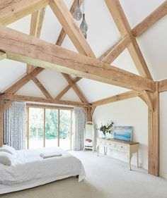 Since 1980 Border Oak have specialised in the design and construction of exceptional bespoke oak framed buildings across the UK and abroad Barn Bedrooms, Oak Bedroom, Master Bedroom, Vaulted Ceiling Bedroom, Vaulted Ceilings, Oak Framed Extensions, Exposed Trusses, Border Oak, Oak Framed Buildings