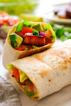 Simple to put together with smoky BBQ tempeh and fresh vegetables. Quick, easy and endlessly adaptable, burritos make a great no-fail weeknight meal!