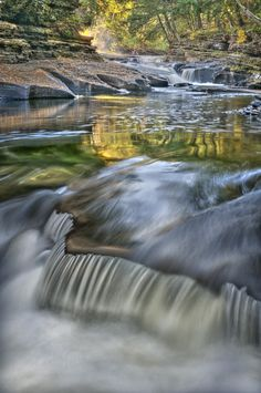 """""""The Presque Isle River and the Manabezho Falls in particular located in the Porcupine Mountains State Park on the Upper Peninsula of Michigan.  The reflections of Fall colors and the unique texture of the water going over the rock edge gives a number of areas to photograph and absorb the beauty."""" - Daniel Ruf"""