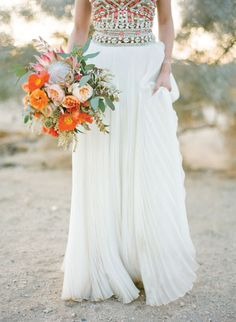 Orange, citrus, soft green and peach flowers with jewelled gown. I like the bouquet but not the gown. I guess im just a little bit more traditional than that