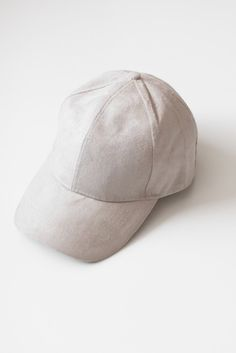Classic baseball cap with a soft faux suede texture. Adjustable velcro  strap in back. b60e611fef3f