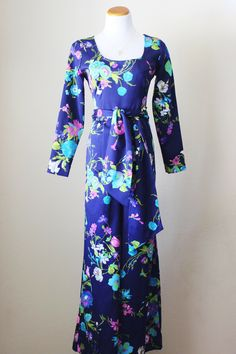 1970s jumpsuit, navy blue with floral pattern, bellbottom, matching sash