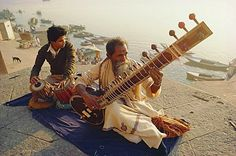 Musicians playing the Sitar and Tabla on the banks of the River Ganges (Ganga), Varanasi