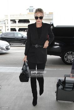 Rosie Huntington-Whiteley is seen at LAX on January 22, 2016 in Los Angeles, California.