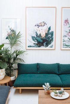 statement dark teal sofa, large artwork, laid back living room