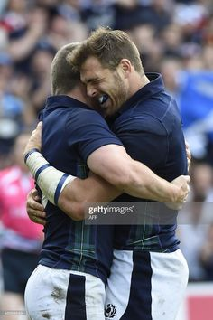 Scotland's centre Mark Bennett (L) celebrates after scoring his team's second try during a Pool B match of the 2015 Rugby World Cup between Scotland and Japan at Kingsholm stadium in Gloucester, west England on September 23, 2015. AFP PHOTO / LOIC VENANCE STILLS