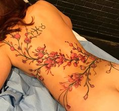 Beautiful Female Full Back Tattoo Design with Flowers